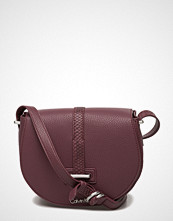 Calvin Klein Poppy Saddle Bag, 63