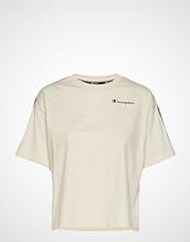 Cènnìs Crewneck Croptop T-shirts & Tops Short-sleeved Creme CHAMPION