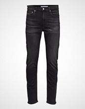 Calvin Klein Ckj 058 Slim Taper Slim Jeans Svart CALVIN KLEIN JEANS