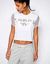 Reebok BOXY SORRY T-SHIRT WITH MESH SLEEVES AND BACK