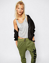 Reebok VEST TOP IN BURN OUT WITH TIE BACK DETAIL