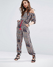Kiss The Sky Allover Festival Print Jumpsuit