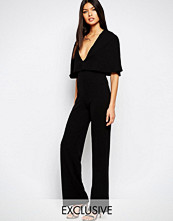 Club L Overlay Plunge Cape Detailed Jumpsuit