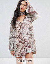 Milk It Vintage Long Sleeve Swing Dress With High Neck Collar In Abstract Animal Print