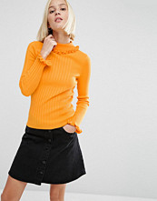 ASOS Jumper In Rib With Ruffle Neck