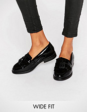 Dune Wide Fit Goodie Black Patent Tassle Loafers