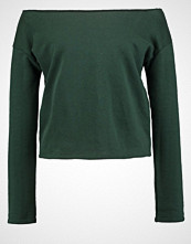 Missguided RAW EDGE CROPPED  Genser forest green