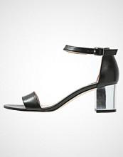 KIOMI Sandaler black/silver