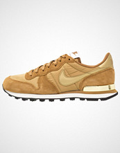 Nike Sportswear INTERNATIONALIST Joggesko ale brown/metallic gold