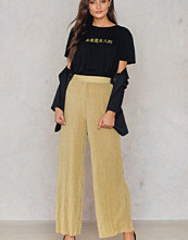 NA-KD Party Glittery Pleated Pants guld