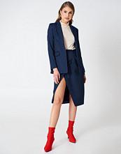 NA-KD Trend Pinstriped Asymmetric Skirt