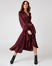 NA-KD Party Wrap Over Satin Frill Dress