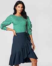 NA-KD Boho Wrap Over Flounce Linen Look Skirt - Minikjolar