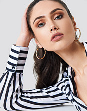 NA-KD Accessories Uneven Hoop Earrings guld