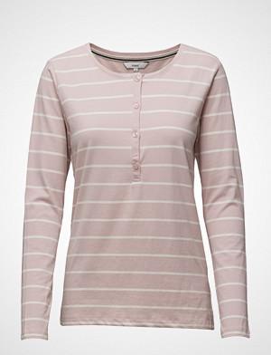 Signal T-skjorte, Tara